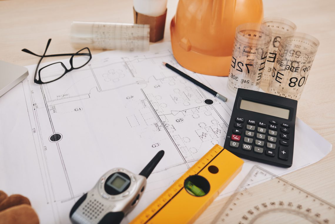 Table with everything for drawing a construction plan