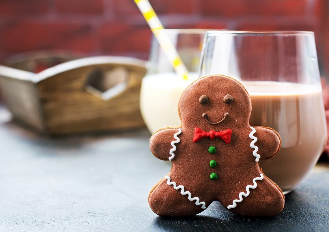 cookies and milk on a table, chocolate milk with ginger cookies