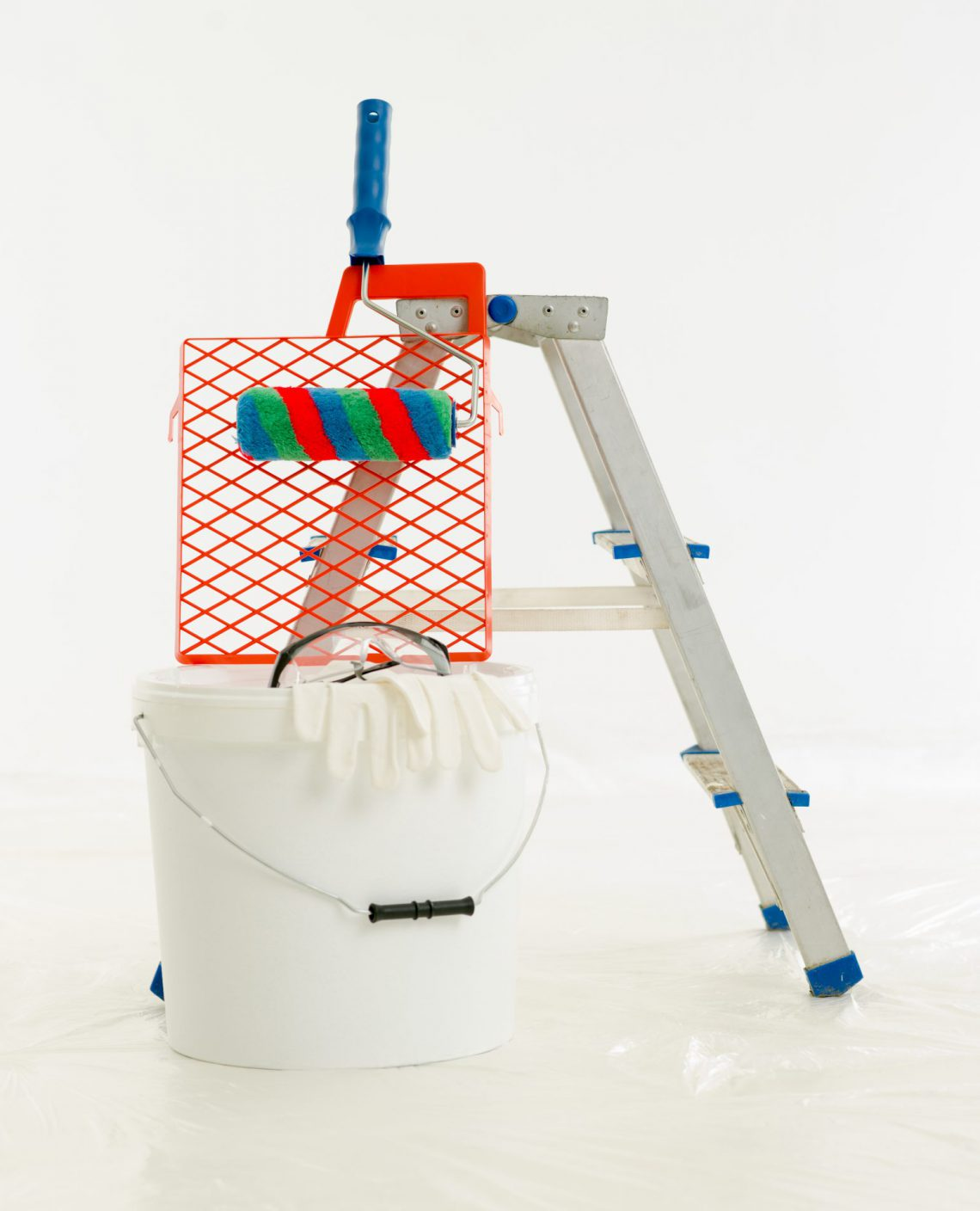 Construction brush, roller, aluminium ladder. The renovation of the house, home repairs. Construction tools, products.