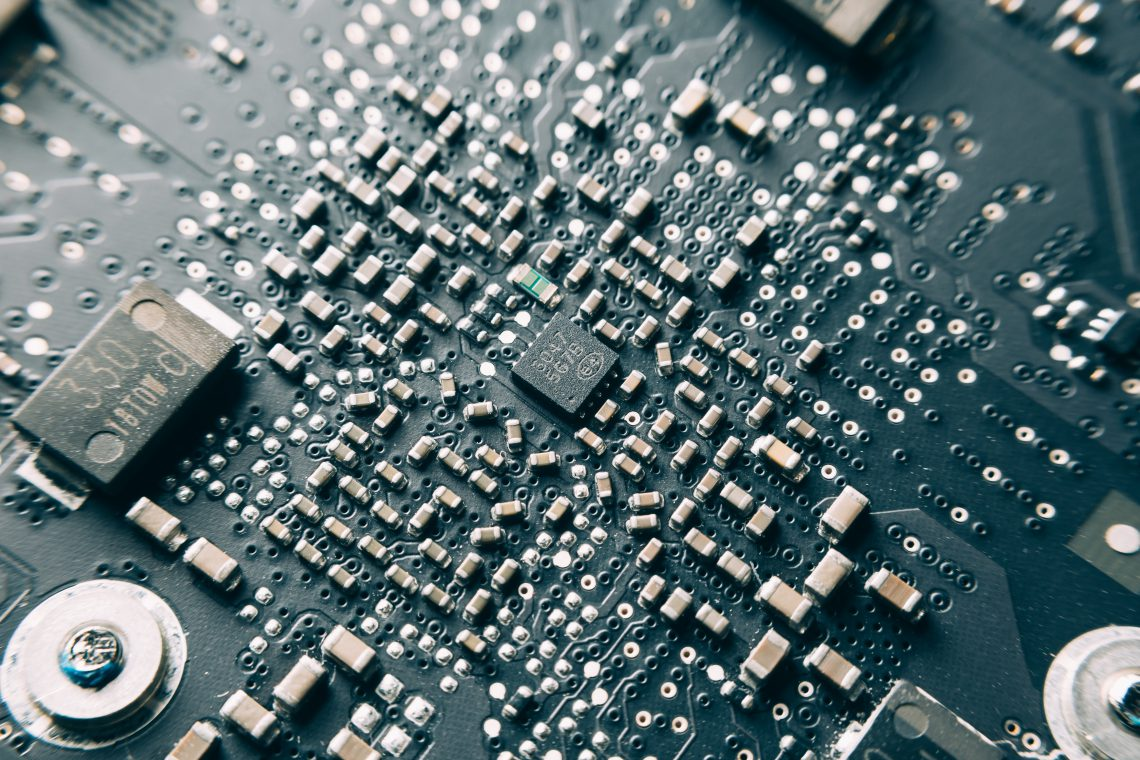 Close-up Shot of Printed Circuit Board with many electrical components.