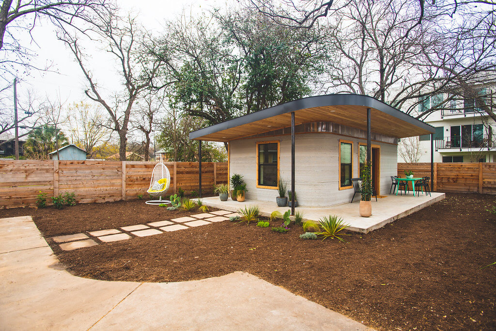 Front and side view of the Icon Labs 3D printed house located in Austin Texas.