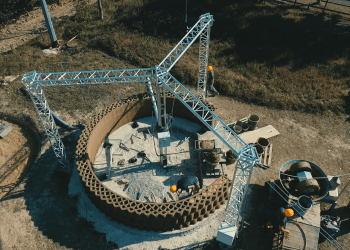 Overhead view of GAIA construction site with a delta style construction 3D printer. Photo curtesy of WASP.