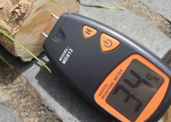 Measuring wood moisture content with a moisture meter. Photo credit: Roo Reynolds