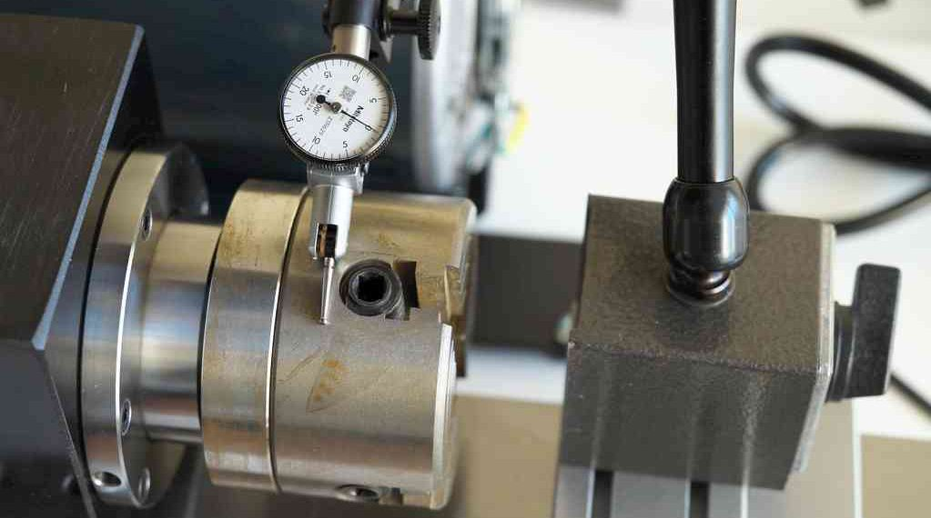 Setting up a dial test indicator for measuring runout on lathe. Photo credit: John L.